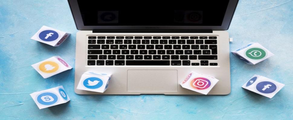 social media icon blocks laptop blue background 23