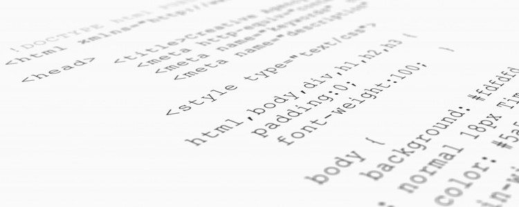 Website HTML code browser view printed white paper closeup view